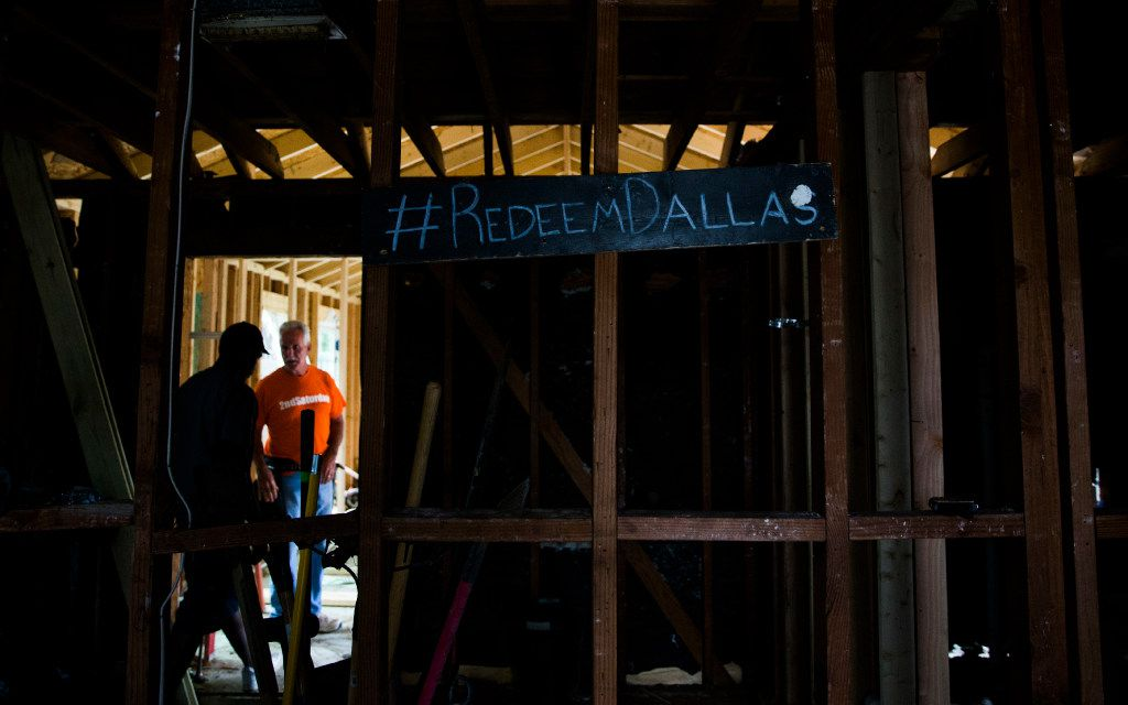 Job foreman Byron Rose, left, and project manager Martin Evans of 2ndSaturday's 2S Industries program, cq, walk around a house they're rebuilding on Thursday, March 16, 2017 on Moffatt Avenue in Oak Cliff. Rose was convicted of armed robbery and served time in prison before finding a job with 2S Industries, which trains and employs ex-inmates for construction and landscaping jobs. (Ashley Landis/The Dallas Morning News)