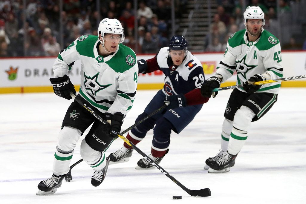 DENVER, CO - NOVEMBER 24: Miro Heiskanen #4 of the Dallas Stars advances the puck against the Colorado Avalanche at the Pepsi Center on November 24, 2018 in Denver, Colorado.  (Photo by Matthew Stockman/Getty Images)