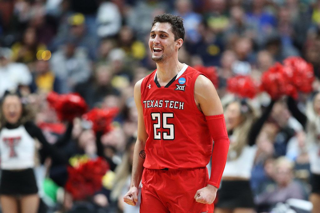 ANAHEIM, CALIFORNIA - MARCH 28: Davide Moretti #25 of the Texas Tech Red Raiders celebrates after a play against the Michigan Wolverines during the 2019 NCAA Men's Basketball Tournament West Regional at Honda Center on March 28, 2019 in Anaheim, California.