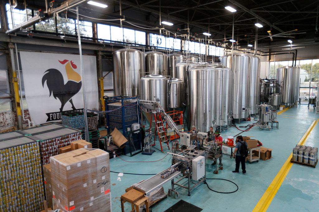 Employees work inside the brewing area at the new Four Corners Brewing Co. facility in the Cedars neighborhood in Dallas, Wednesday, Oct. 18, 2017.