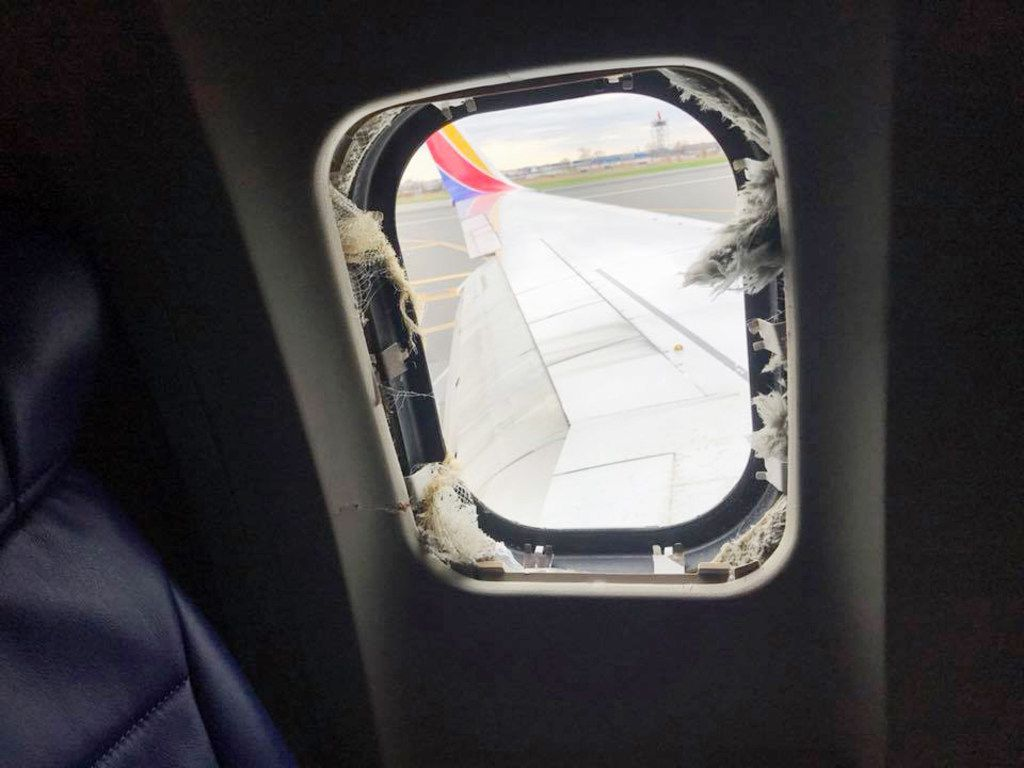 View of the blown-out window from Southwest Airlines Flight 1380 at Philadelphia International Airport on Tuesday. The flight was bound for Dallas from New York but suffered engine failure and was forced to make an emergency landing in Philadelphia. (Marty Martinez)