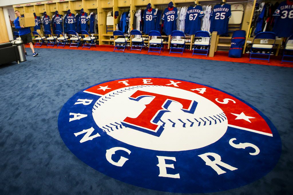 Staff members carry boxes through the clubhouse at the Texas Rangers newly renovated spring training facility during a media tour on Thursday, Feb. 18, 2016, in Surprise, Ariz. (Smiley N. Pool/The Dallas Morning News)