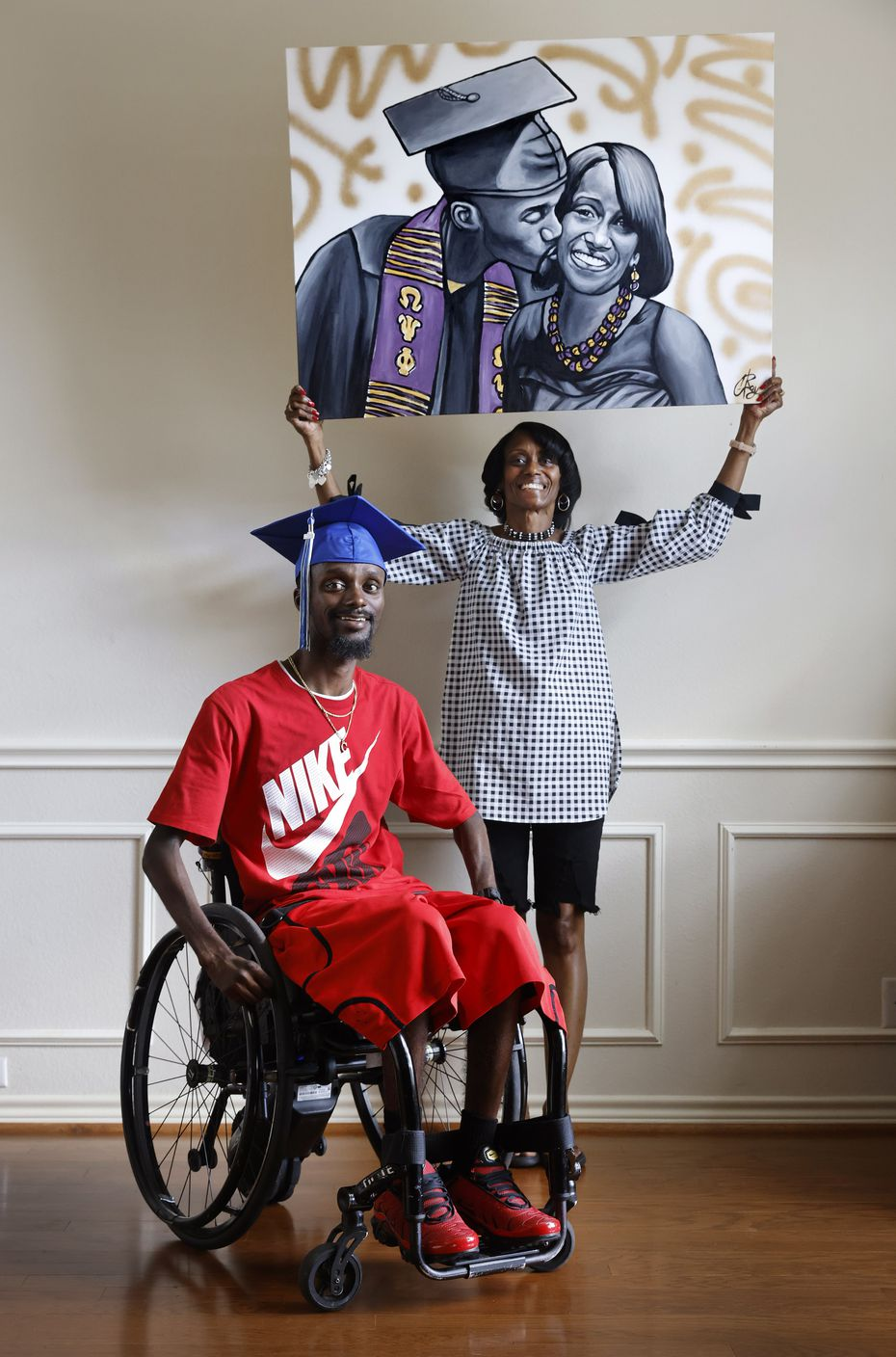 Charlotte Borner holds a graduation painting by artist Chris Rayson of her with son Corey Borner at their DeSoto home on Sept. 16, 2021.