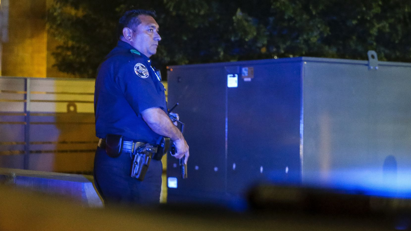 Dallas Police Deputy Chief Israel Herrera looks to a fellow officer during a felony traffic stop after seeing gunshots fired from a vehicle in downtown Dallas on Friday, Sept. 24, 2021.
