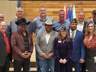 In a screenshot from Facebook, a photo on Frisco City Council member Dan Stricklin's campaign page shows Stricklin (back row, second from left) next to council members Brian Livingston and John Keating and Mayor Jeff Cheney (second from right) with about 10 other people without masks at a Dec. 10, 2020, veterans Christmas event at Verona Villa in Frisco.