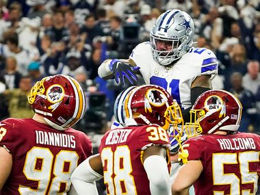 Dallas Cowboys running back Ezekiel Elliott (21) celebrates with center Travis Frederick (72) after scoring on a touchdown run during the first half of an NFL football game against the Washington Redskins at AT&T Stadium on Sunday, Dec. 29, 2019, in Arlington.