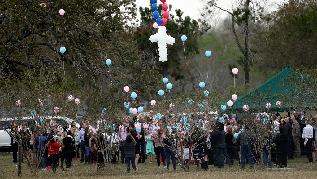 Balloons are released Nov. 15 at a graveside service for members of the Holcombe family who were killed in the Sutherland Springs Baptist Church shooting. A man opened fire inside the church in the small South Texas community Nov. 5, killing more than two dozen. (AP Photo/Eric Gay)