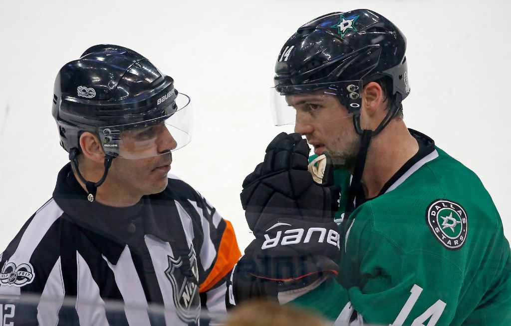 Dallas Stars left wing Jamie Benn (14) talks with a referee while another referee reviews a play during the third period at American Airlines Center in Dallas, Thursday, Jan. 26, 2017. The Dallas Stars won 4-3. (Jae S. Lee/The Dallas Morning News)