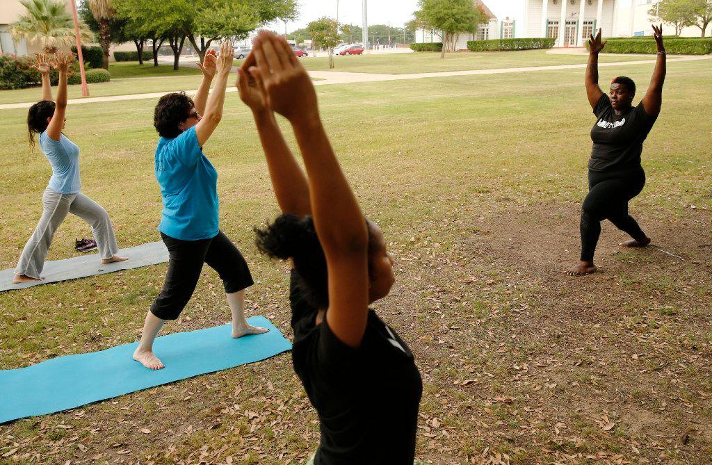 Instructor Ebony Smith leads a Yoga N Da Hood class at Fair Park in Dallas.