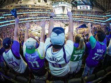 Dallas Mavericks fans, all wearing guard Luka Doncic #77 jerseys, cheer a basket during the first quarter of an NBA playoff basketball game against the LA Clippers at American Airlines Center on Friday, May 28, 2021, in Dallas.