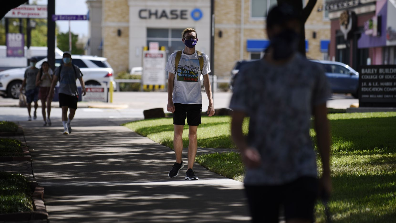 Texas Christian University students walk towards the Clark Hall dormitory on the campus of TCU in Fort Worth, Aug. 27, 2020. TCU went from 111 COVID-19 cases on Monday to 360 cases on today. Ben Torres/Special Contributor