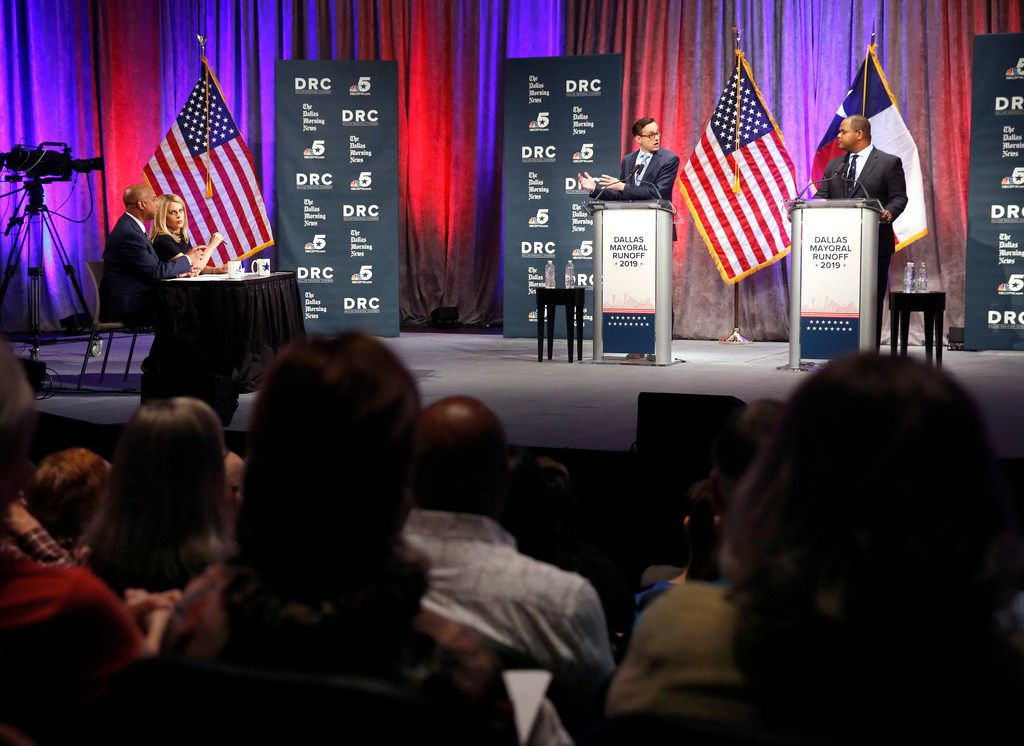Dallas City Council member Scott Griggs (center) and State Rep. Eric Johnson, D-Dallas (right), debate during a televised one-hour debate sponsored by The Dallas Morning News, NBC5 and the Dallas Regional Chamber at El Centro College in downtown Dallas, Tuesday, May 14, 2019. Dallas Morning News political reporter Gromer Jeffers (left) and NBC 5 political reporter Julie Fine moderate the debate.  The two candidates are in a runoff election to become Dallas Mayor. (Tom Fox/The Dallas Morning News)