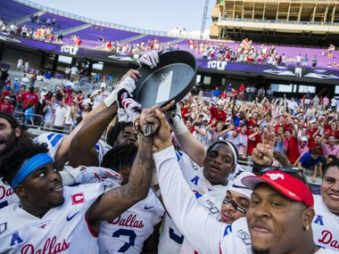 "Southern Methodist Mustangs celebrate a 41-38 win over TCU Horned Frogs by hoisting the ""Iron Skillet"" on Saturday, September 21, 2019 at Amon G. Carter Stadium in Fort Worth."