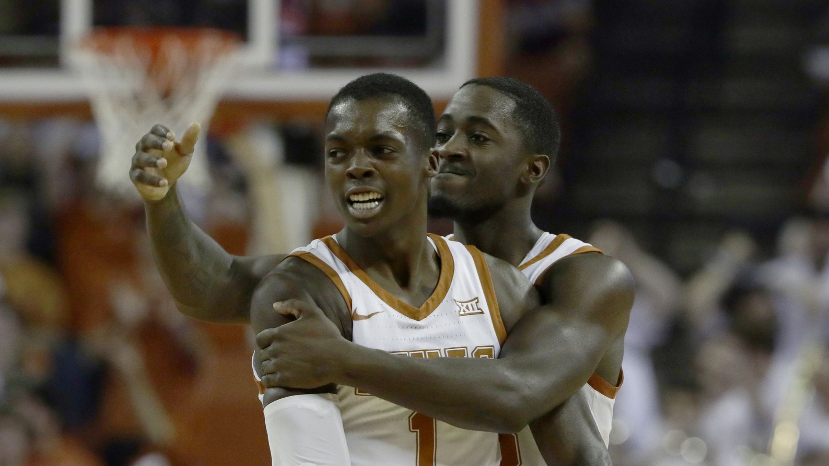 Texas guard Andrew Jones (1) and guard Courtney Ramey (3) celebrate a score against Kansas during the first half of an NCAA college basketball game, Saturday, Jan. 18, 2020, in Austin, Texas.