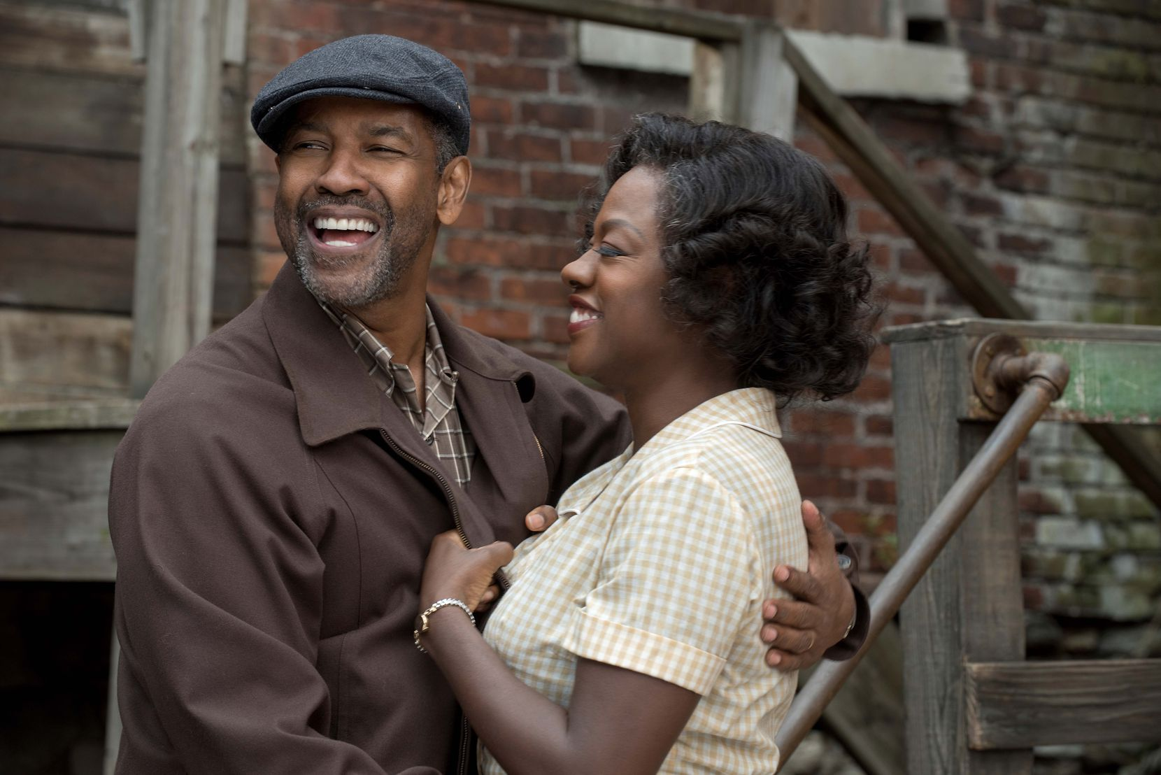 "Denzel Washington, left, and Viola Davis in a scene from, ""Fences."""