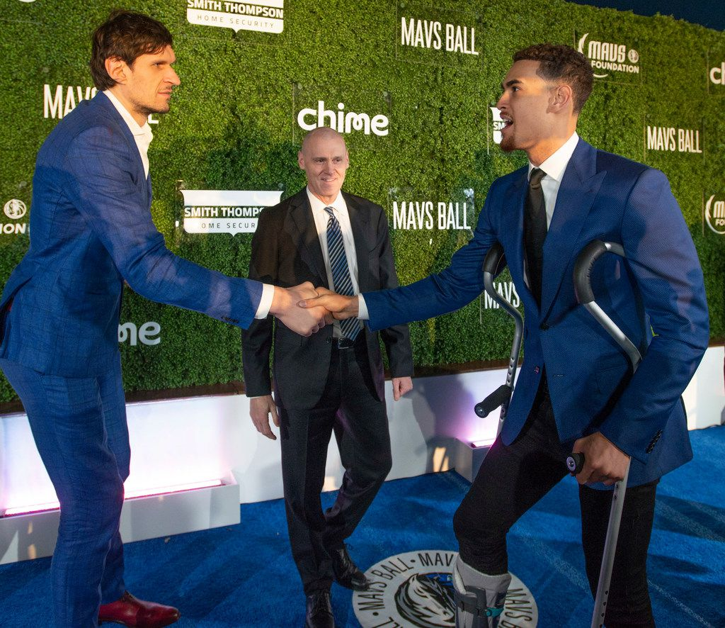 Mavs players Boban Marjanovic and Dwight Powell greet each other as head coach Rick Carlisle looks on on the blue carpet prior to the Mavs Ball at Million Air in Addison, Texas on March 7, 2020. (Robert W. Hart/Special Contributor)