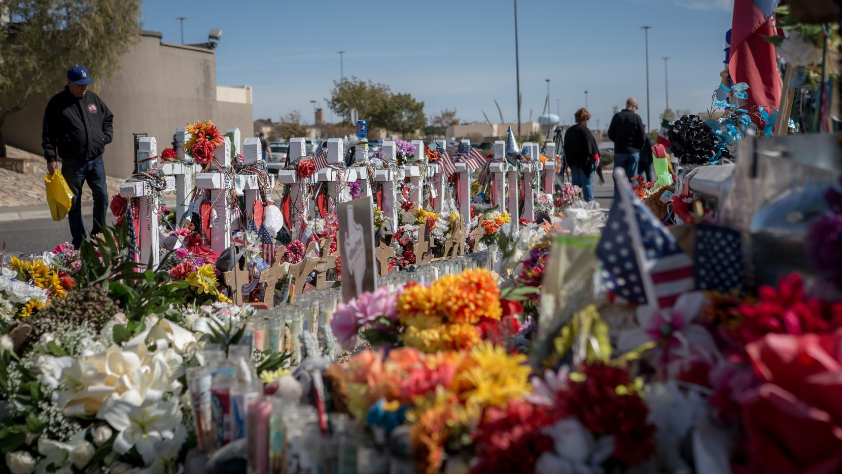 Friends and families of the victims of the August 3 massacre in El Paso visit the site of the Walmart where the shooting occurred.