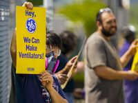 Members of the industrial division of the Communications Workers of America protest outside GE Energy's Dallas facility on Manor Way near Love Field.