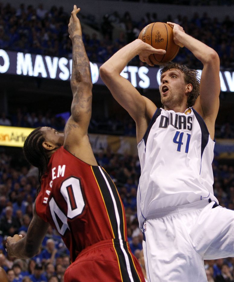 Miami Heat power forward Udonis Haslem (40) defends Dallas Mavericks power forward Dirk Nowitzki (41) in the second quarter during Game 3 of the NBA Finals at American Airlines Center Sunday, June 5, 2011 in Dallas.  (Tom Fox/The Dallas Morning News)