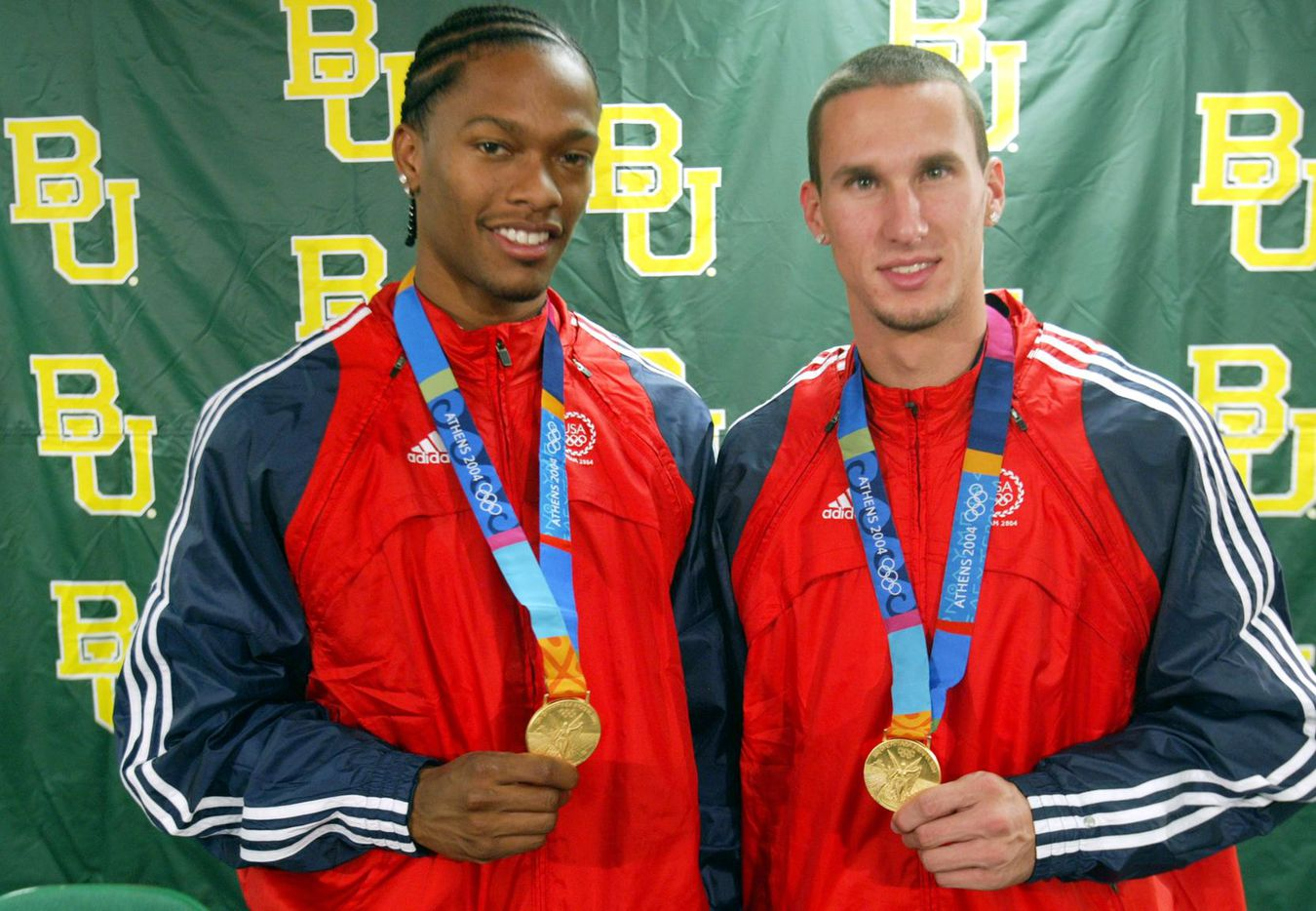 From 2004: Baylor senior Darold Williamson, left, and junior Jeremy Wariner, right, pose with the gold medals they won  at the Athens Olympics.  Wariner won gold in the 400 meter race and both Wariner and Williamson won gold as part of the 4x400 relay team.  Baylor coach Clyde Hart helped train them for the events.