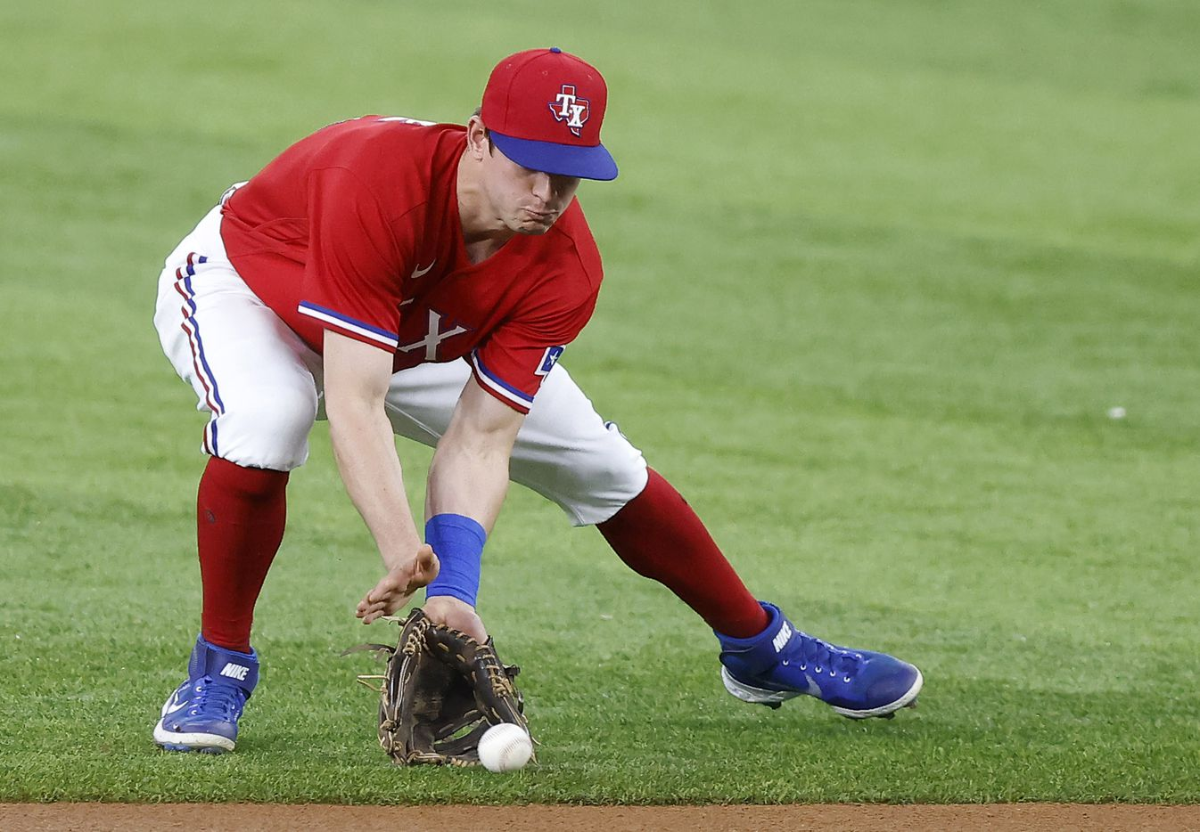 Texas Rangers second baseman Nick Solak (15) fields a batted ball and throws pout Houston Astros Alex Bregman during the first inning at Globe Life Field in Arlington, Texas, Friday, May 21, 2021. (Tom Fox/The Dallas Morning News)