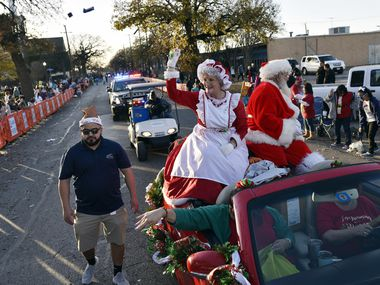 In this 2018 file photo, Mrs. Claus and Santa Claus wave to families while tossing candy as they close the Irving Holiday Extravaganza parade through the Heritage District in Irving. The COVID-19 pandemic hasn't curtailed the couple's busy holiday schedule, and Mrs. Claus will be accepting wish lists from children in Allen in an upcoming virtual meet-and-greet.