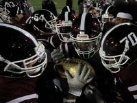 Members of the Red Oak Hawks marvel at the golden football atop a trophy presented after they finished on top of the District 6-5A Division ll competition to receive the coveted district acknowledgement. It marked the first time since 1982 that the hawks have received the honor as lone district champions. Red oak defeated Seagoville 48-13 in their regular season finale played at Billy Goodloe Stadium in Red Oak on November 7, 2019.