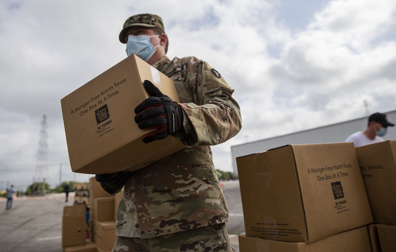 More than 250 members of the Texas National Guard have been helping the North Texas Food Bank prepare and distribute meals to the hungry.