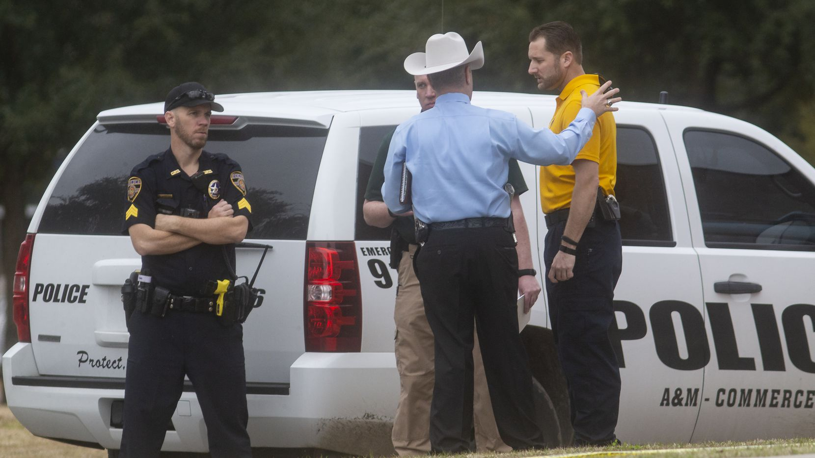 Law enforcement officers gather outside of the Pride Rock residence hall where there was as shooting at Texas A&M University-Commerce on Feb. 3, 2020 in Commerce, Texas.