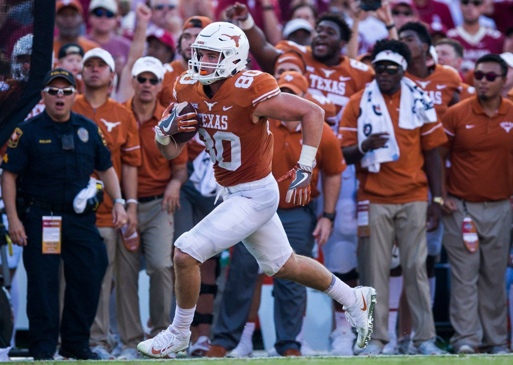 Texas Longhorns tight end Cade Brewer (80) runs the ball during the third quarter of the AT&T Red River Showdown college football game between the University of Texas and Oklahoma University on Saturday, October 14, 2017 at the Cotton Bowl in Fair Park in Dallas. (Ashley Landis/The Dallas Morning News)