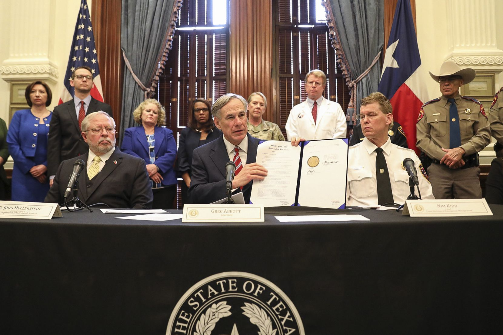 Texas' 10 public health laboratories aren't able to test people who do not have symptoms of COVID-19, state Health Services Commissioner John Hellerstedt (seated at left) said Friday