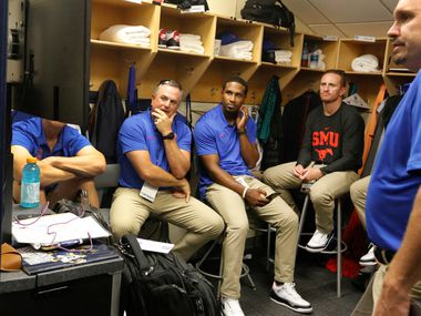 FILE - SMU head coach Sonny Dykes watches film with his assistants in the cramped coaches locker room before a game against Michigan at Michigan Stadium in Ann Arbor, Mich., on Saturday, Sept. 15, 2018.