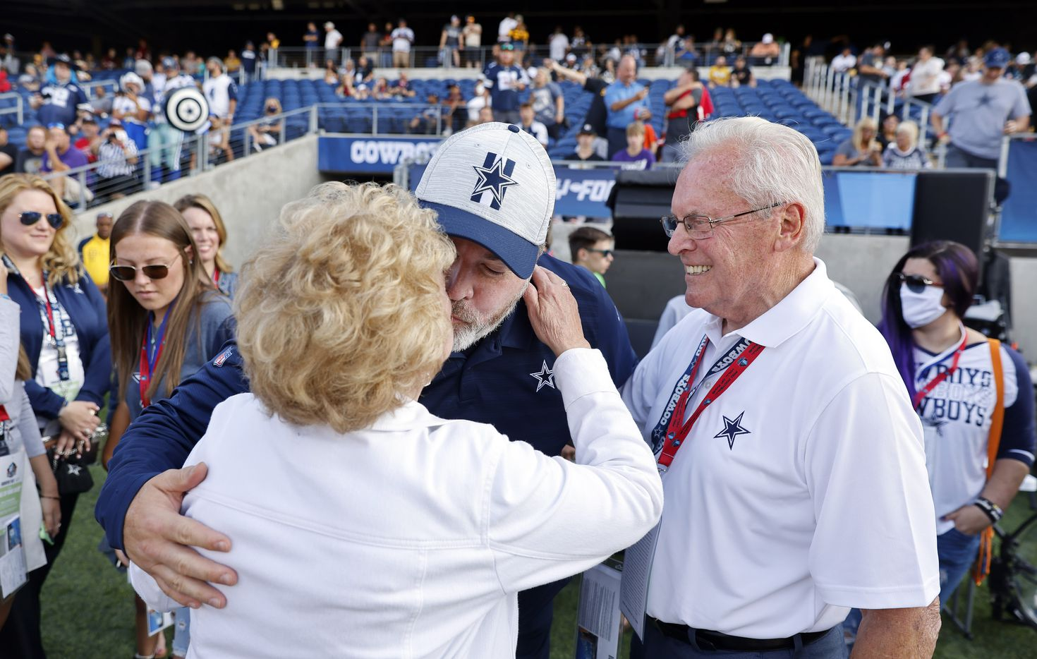 Cowboys head coach Mike McCarthy gives his mother Ellen McCarthy a kiss before their first preseason game against the Pittsburgh Steelers at Tom Benson Hall of Fame Stadium in Canton, Ohio, Thursday, August 5, 2021. Standing on the right is his father Joe McCarthy, both from the Greenfield neighborhood in Pittsburgh. (Tom Fox/The Dallas Morning News)