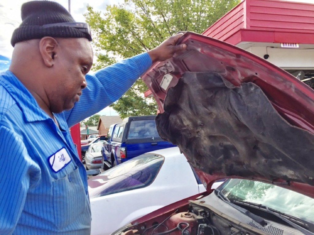 Jeff Fleming looks at Toni Brown's Ford Focus, which he kept for a year and a half even though she paid him thousands of dollars. The Denton auto shop owner ended up losing a $92,000 judgment in the case when he failed to show up for court.