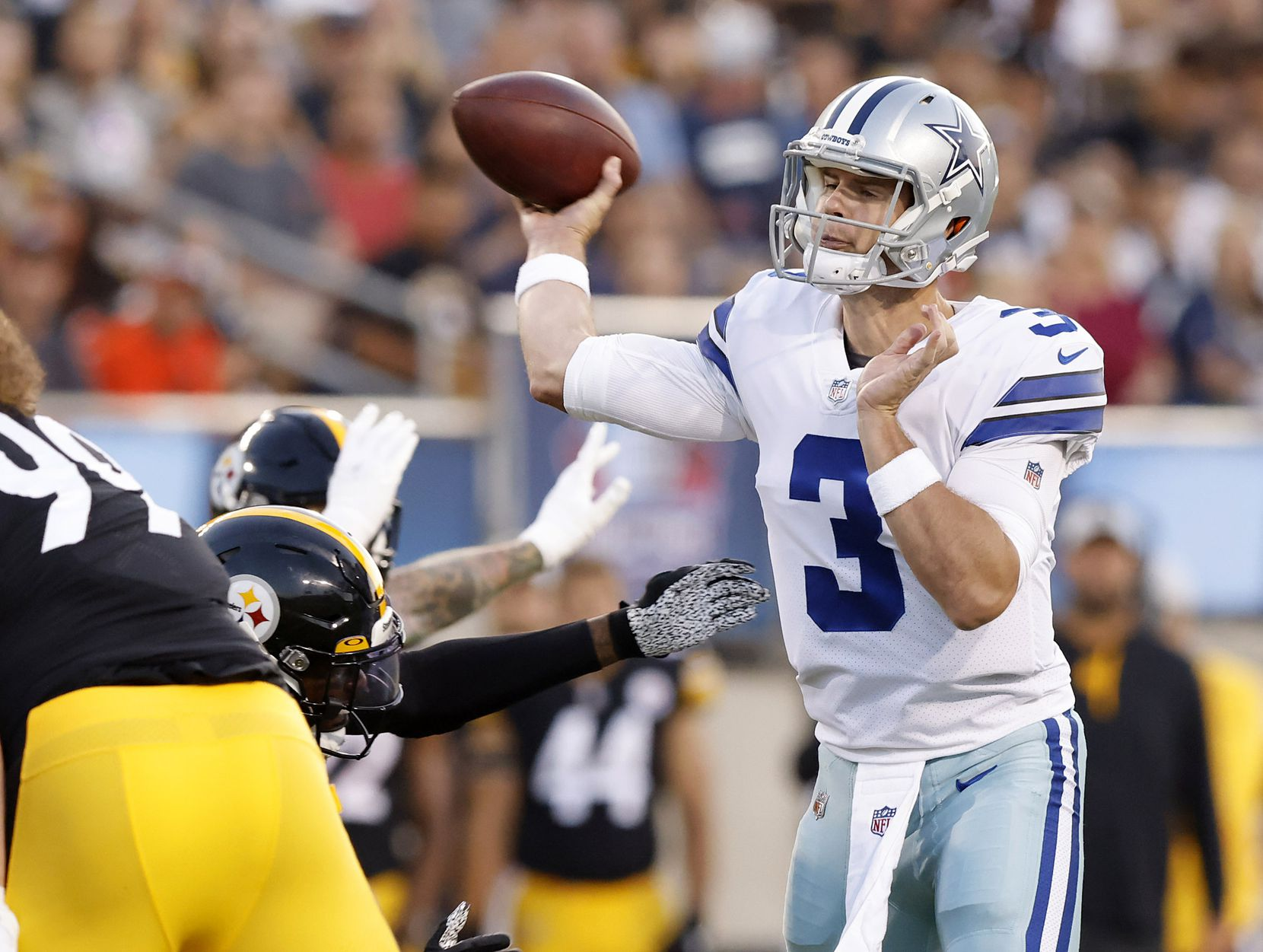 Dallas Cowboys quarterback Garrett Gilbert (3) releases a first quarter pass before being hit by a Pittsburgh Steelers defender during the first quarter of their preseason game at Tom Benson Hall of Fame Stadium in Canton, Ohio, Thursday, August 5, 2021. (Tom Fox/The Dallas Morning News)