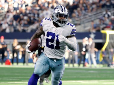 Dallas Cowboys running back Ezekiel Elliott (21) carries the ball for a touchdown in the second half of an NFL football game against the New York Giants in Arlington, Texas, Sunday, Oct. 10, 2021.