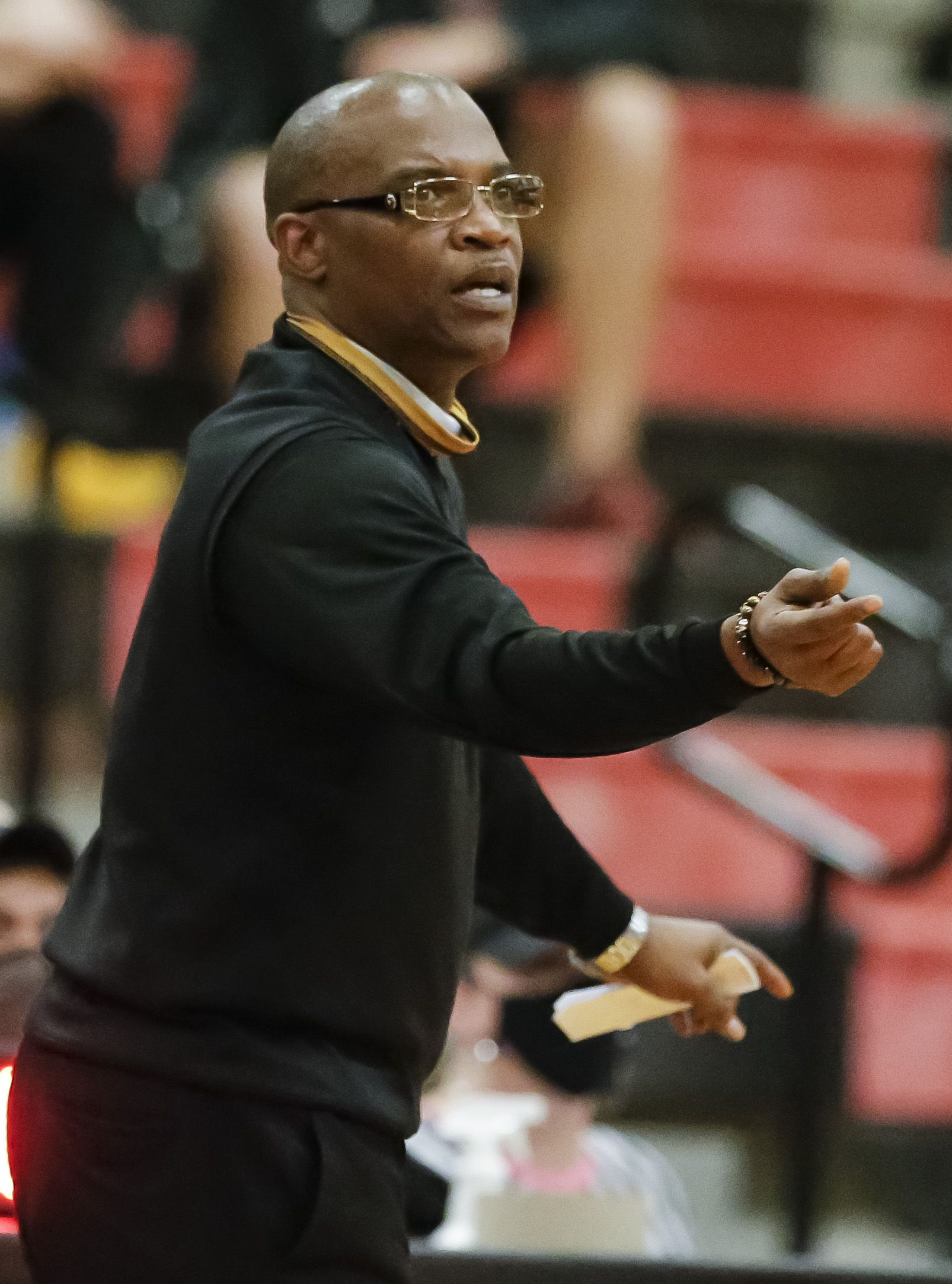 South Oak Cliff head coach James Mays II gives instructions to his players during the first half of a Class 5A area-round playoff basketball game against Love Joy at Lake Highlands High School in Dallas, Wednesday, February 24, 2021. South Oak Cliff won 46-44. (Brandon Wade/Special Contributor)