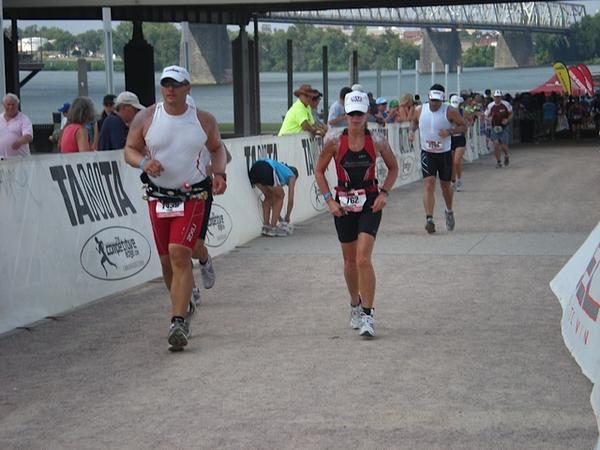 Hoffman (right) runs the last leg of the 2010 Louisville Ironman triathlon after swimming 2.4 miles and biking 112 miles.