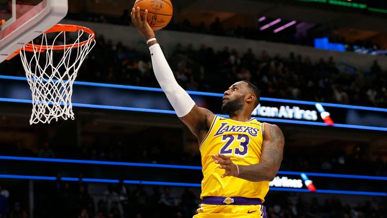 Los Angeles Lakers forward LeBron James (23) attempts a layup as Los Angeles Lakers forward Anthony Davis (3) watches in a game against the Dallas Mavericks during the second half of play at American Airlines Center in Dallas on Friday, November 1, 2019.