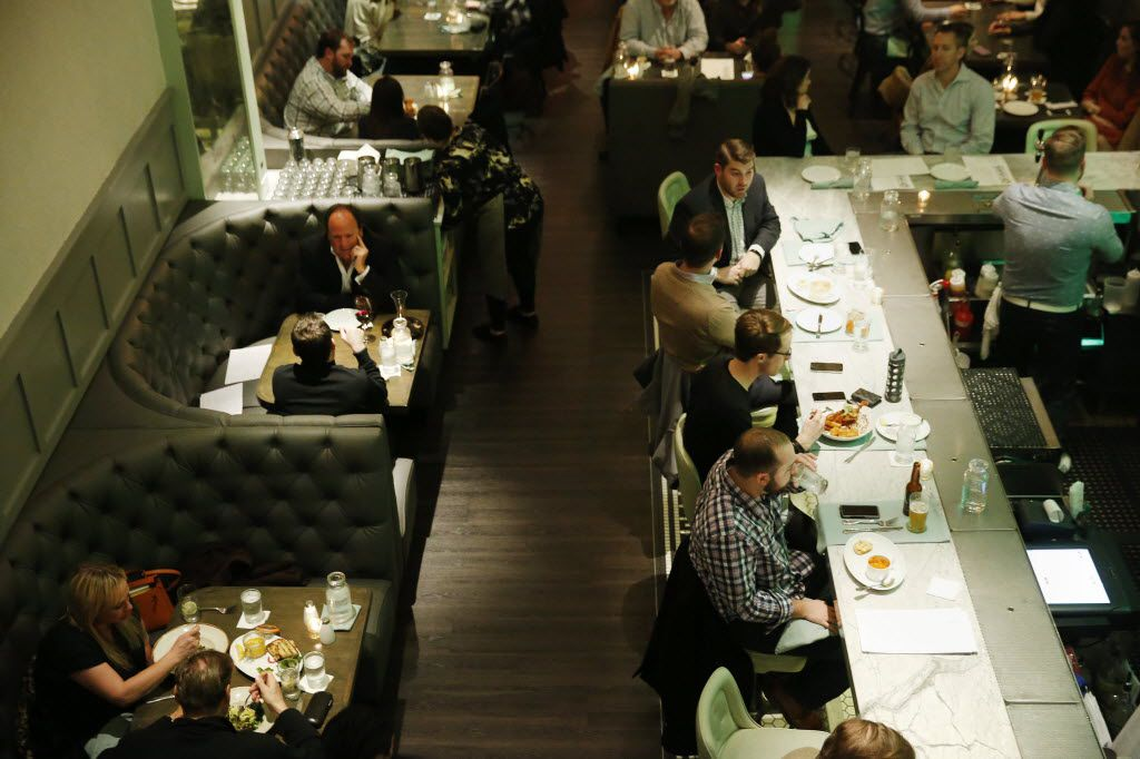 A view of the bar and dining room from the mezzanine, which has additional seating