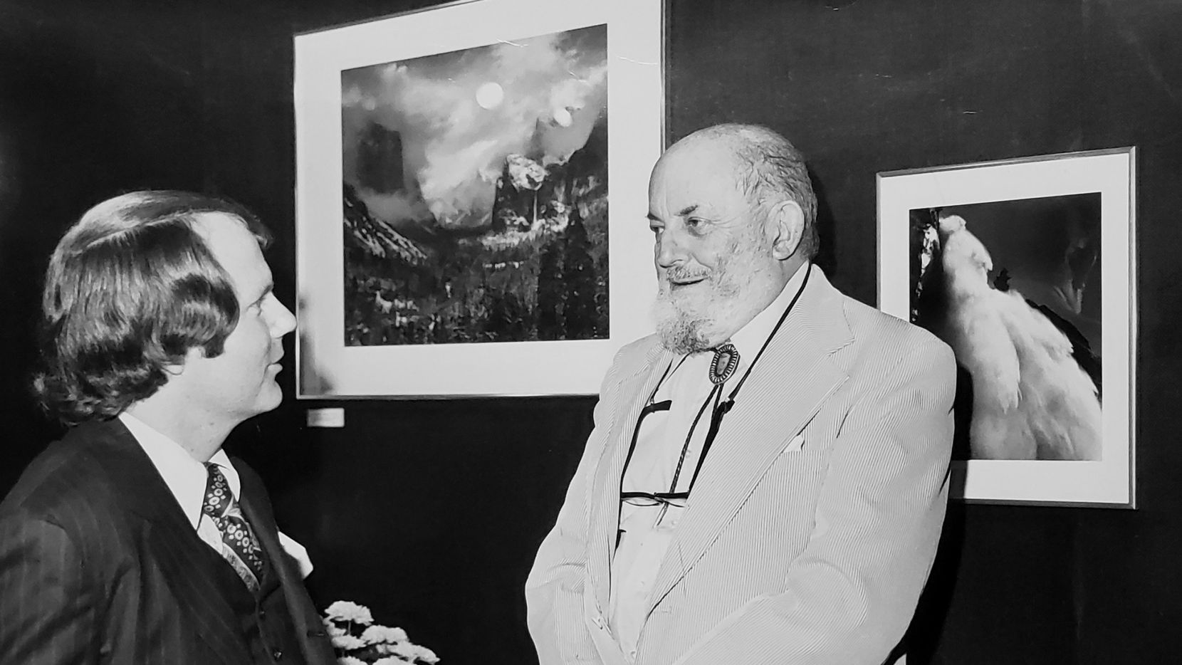 Ben Breard spoke with renowned landscape photographer Ansel Adams at a reception in the gallery in 1973.