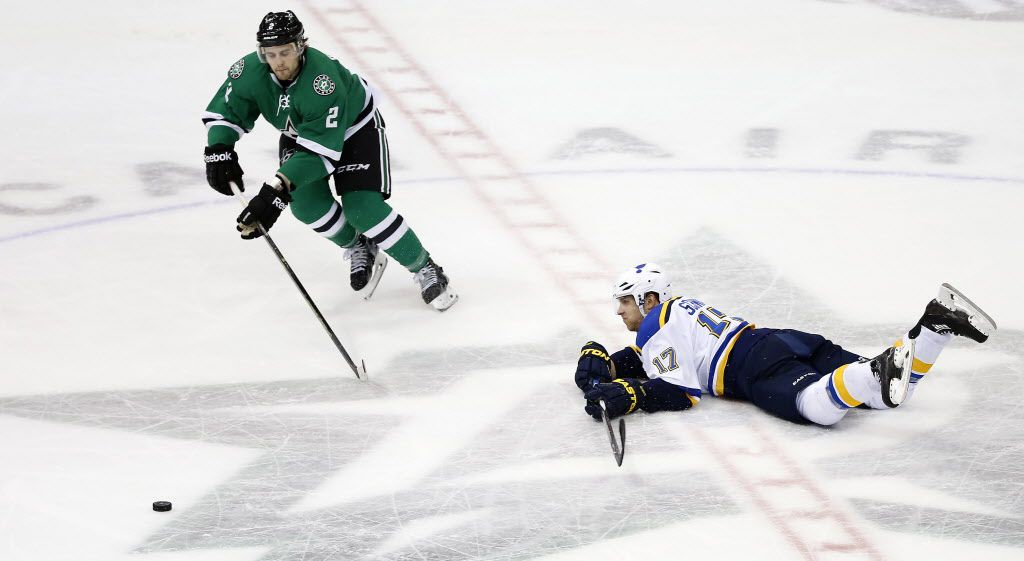 St. Louis Blues left wing Jaden Schwartz (17) dives to clear the puck away from Dallas Stars defenseman Kris Russell during the second period at American Airlines Center in Dallas, Saturday, March 12, 2016. (Jae S. Lee/The Dallas Morning News)