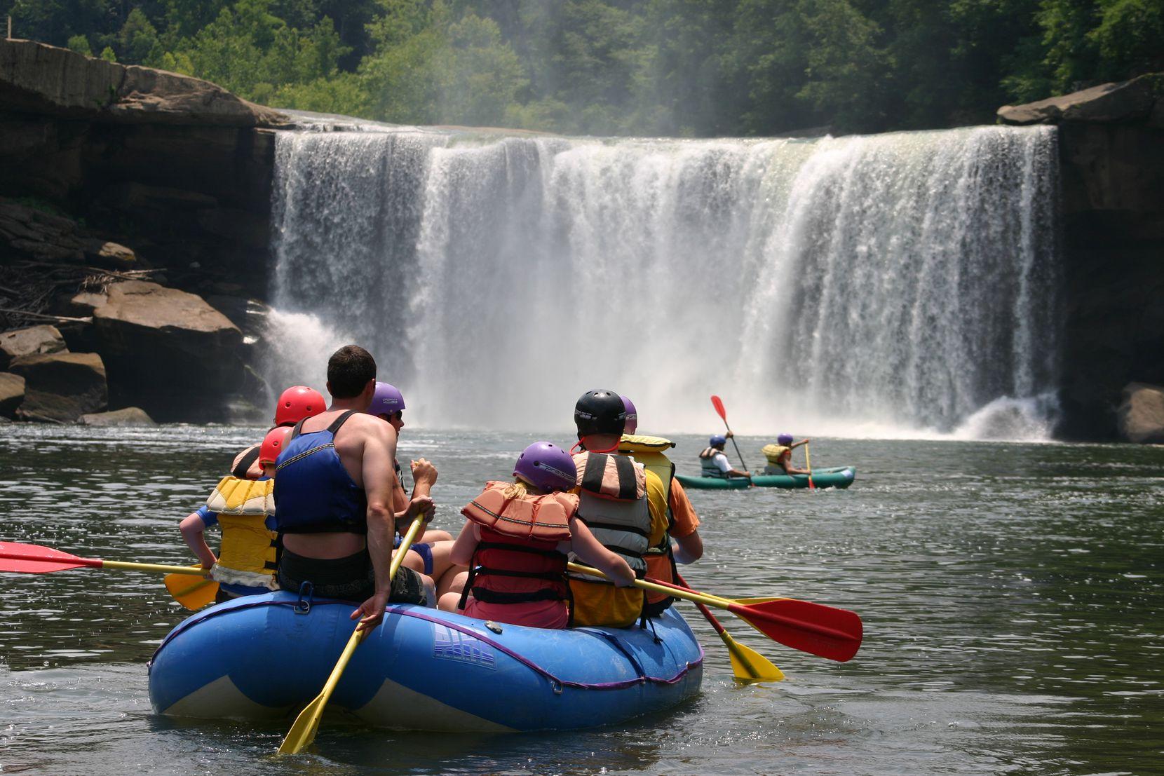 Visitors enjoy rafting near the base of Cumberland Falls in Kentucky.