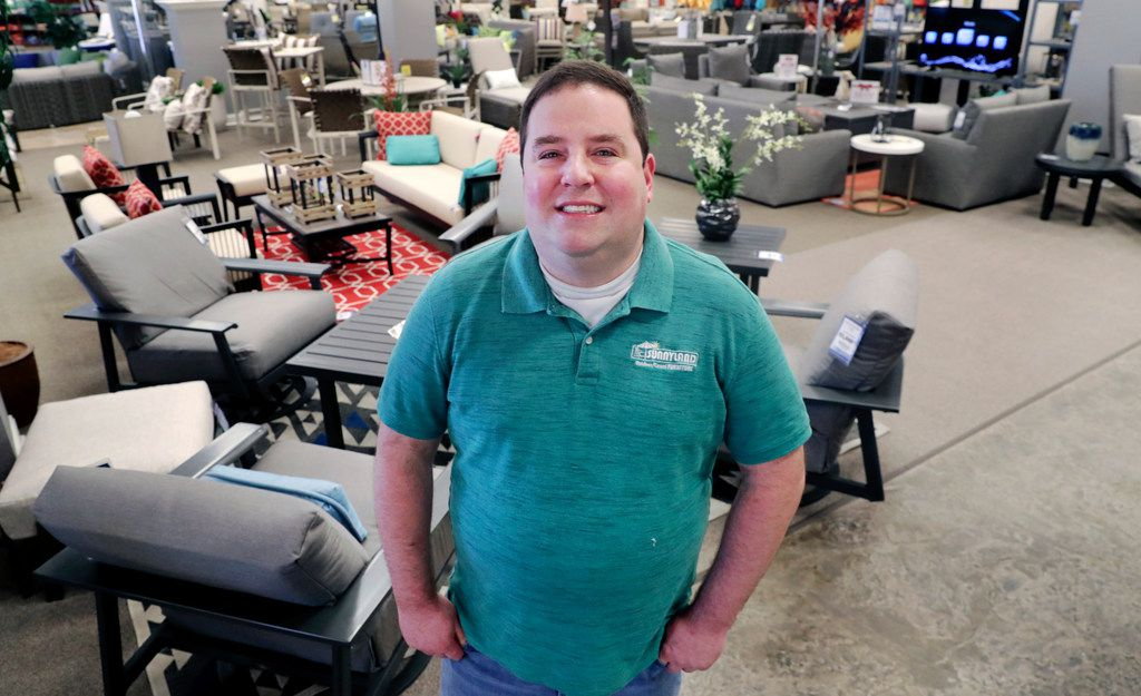 In this Tuesday, Dec. 11, 2018, photo Brad Schweig, co-owner of Sunnyland Furniture, poses for a photo at his store in Dallas.