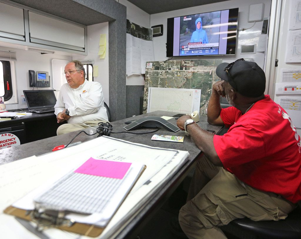 Army Corps of Engineers' Richard Long, left, and Brooks Hubbard man the emergency center trailer at the Barker Reservoir in west Houston on Monday, September 11, 2017. (Louis DeLuca/The Dallas Morning News)