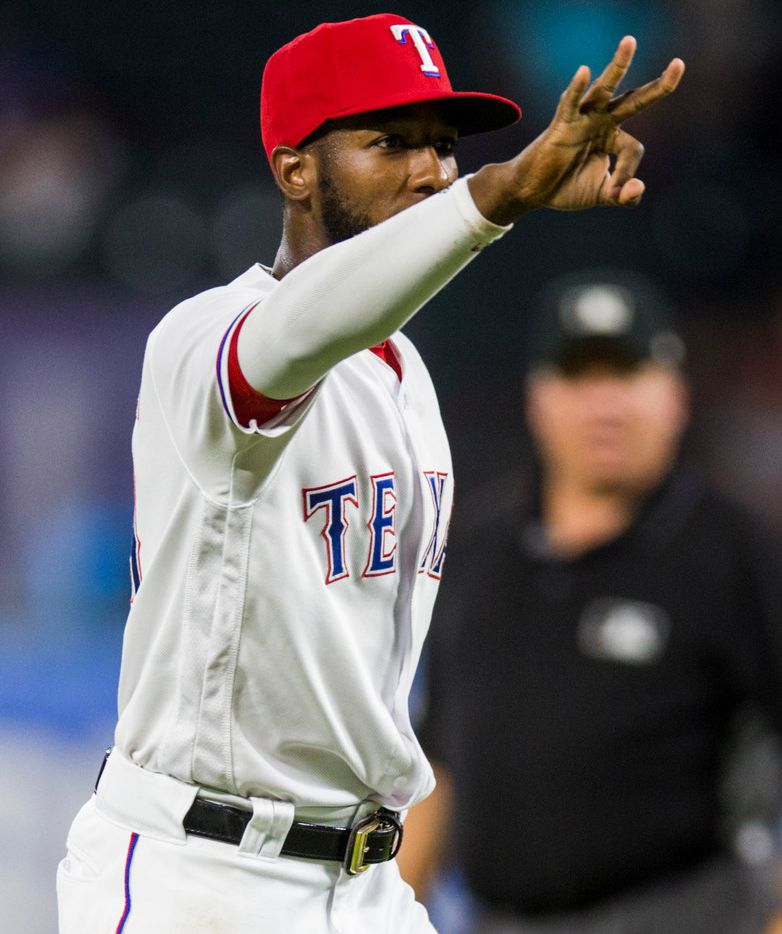 Texas Rangers shortstop Jurickson Profar (19) celebrates a triple play during the fourth inning of an MLB game between the Texas Rangers and the Los Angeles Angels on Thursday, August 16, 2018 at Globe Life Park in Arlington. (Ashley Landis/The Dallas Morning News)
