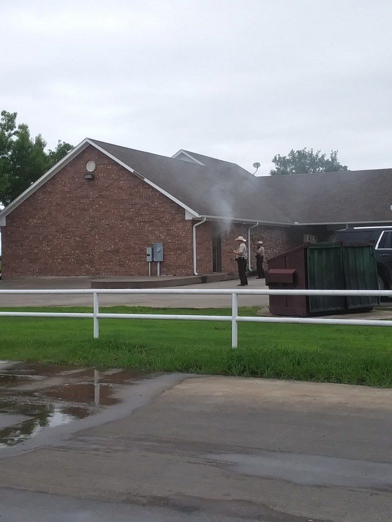 Smoke errupts from the doors of the Enloe State Bank On May 11, 2019. (Courtesy of Teresa Thompson)