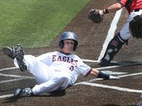Allen Eagles shortstop Mason LaPlante (5) slid safely into home to score as a result of a single by first baseman Cole Maxwell (3) during the first inning of play against Killeen Harker Heights. Allen won the game 2-1 to advance. The two teams played Game 3 of a best-of-3 baseball playoff series held at Corsicana High School in Corsicana on May 13, 2017. (Steve Hamm/Special Contributor)