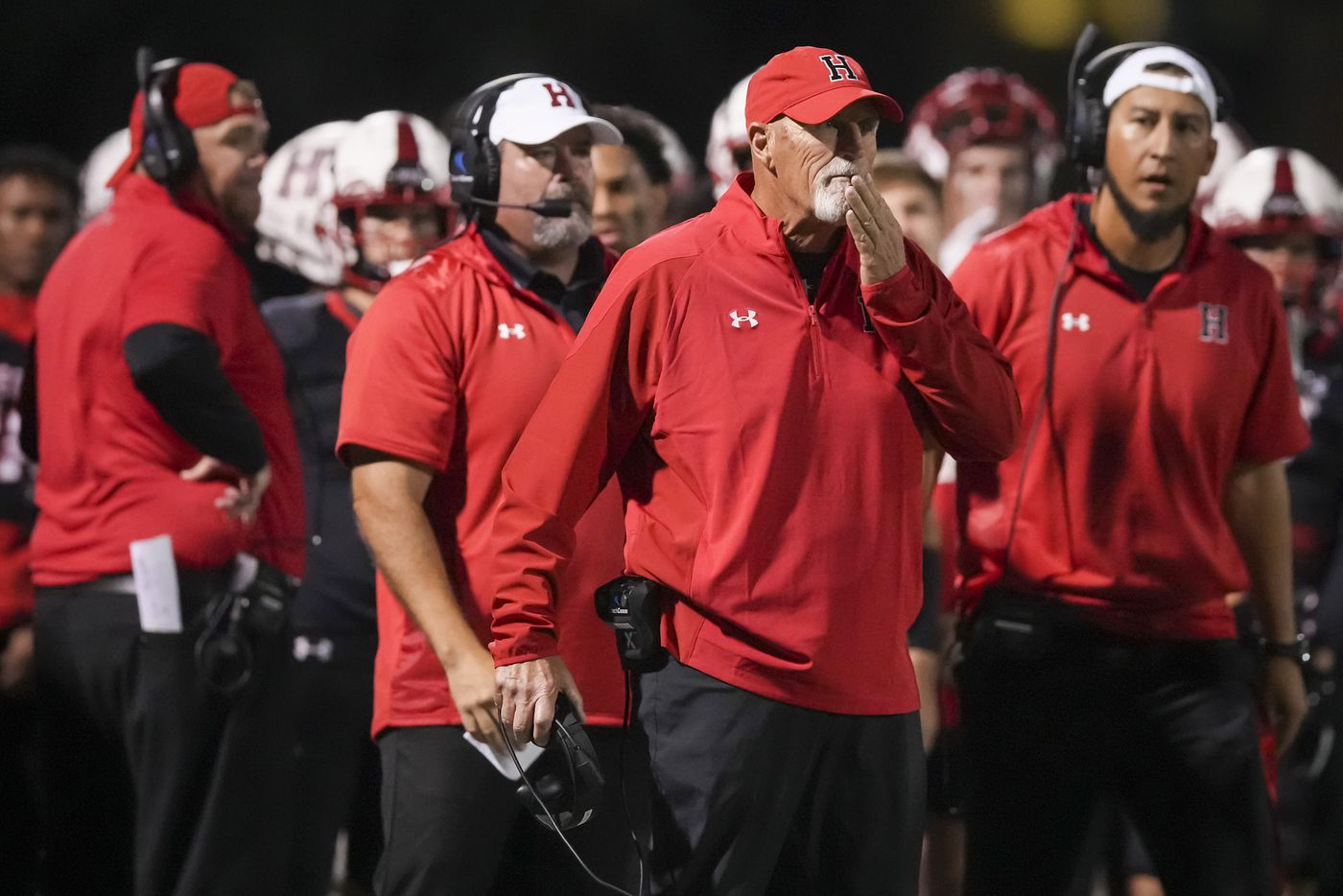 Rockwall-Heath head coach Mike Spradlin works on the sidelines during the second half of a District 10-6A high school football game against Rockwall at Wilkerson-Sanders Stadium on Friday, Sept. 24, 2021, in Rockwall.  Rockwall-Heath won the game 79-71 in double overtime.