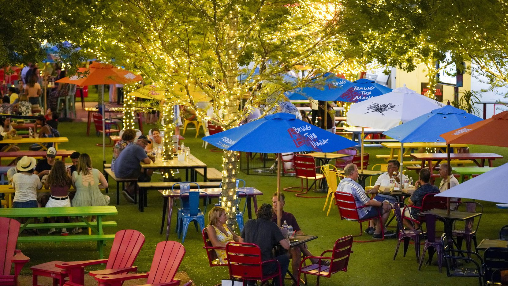 The ArtPark at Trinity Groves has picnic tables, Adirondack chairs and 28 TVs.